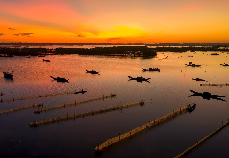 Sunrise on the lagoon Hue- Culture Pham Travel