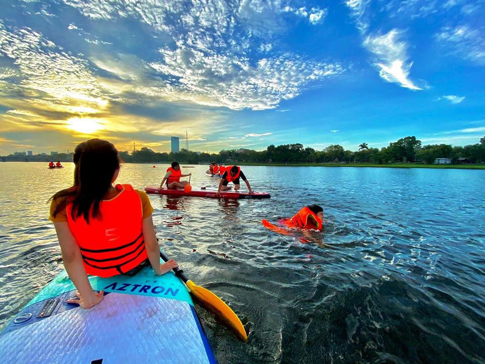 Surfing sup on the Perfume River- Cuture Pham Travel